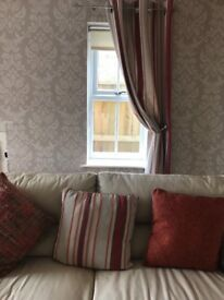 2 pairs of orange striped eyelet curtains and matching cushions also from next home