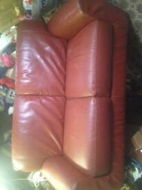 Two seater rust brown sofa