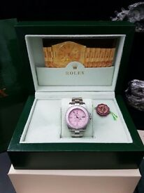 Brand new ladies Rolex Submariner pink face/bezel and silver strap all boxed and bagged Paperwork