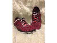 Almost new pink leopard print Nike Free Run TR FIT 4