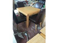 Oak dining table & 4 brown faux leather chairs