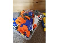 Assortment of nerf guns with bullets