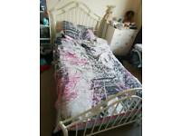 White metal single bed