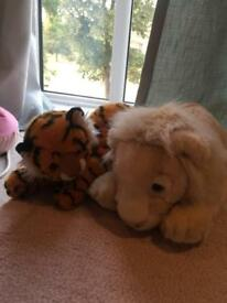 White lion and tiger plush toy set.