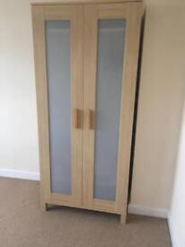 Ikea wardrobe with clear fronts