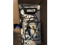 Xbox 360 console and a controller
