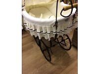 Vintage style on wheels baby's crib beige and black frame