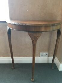 Half moon occasional table