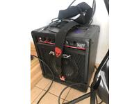 Peavey bass guitar, amp, strap and pick.