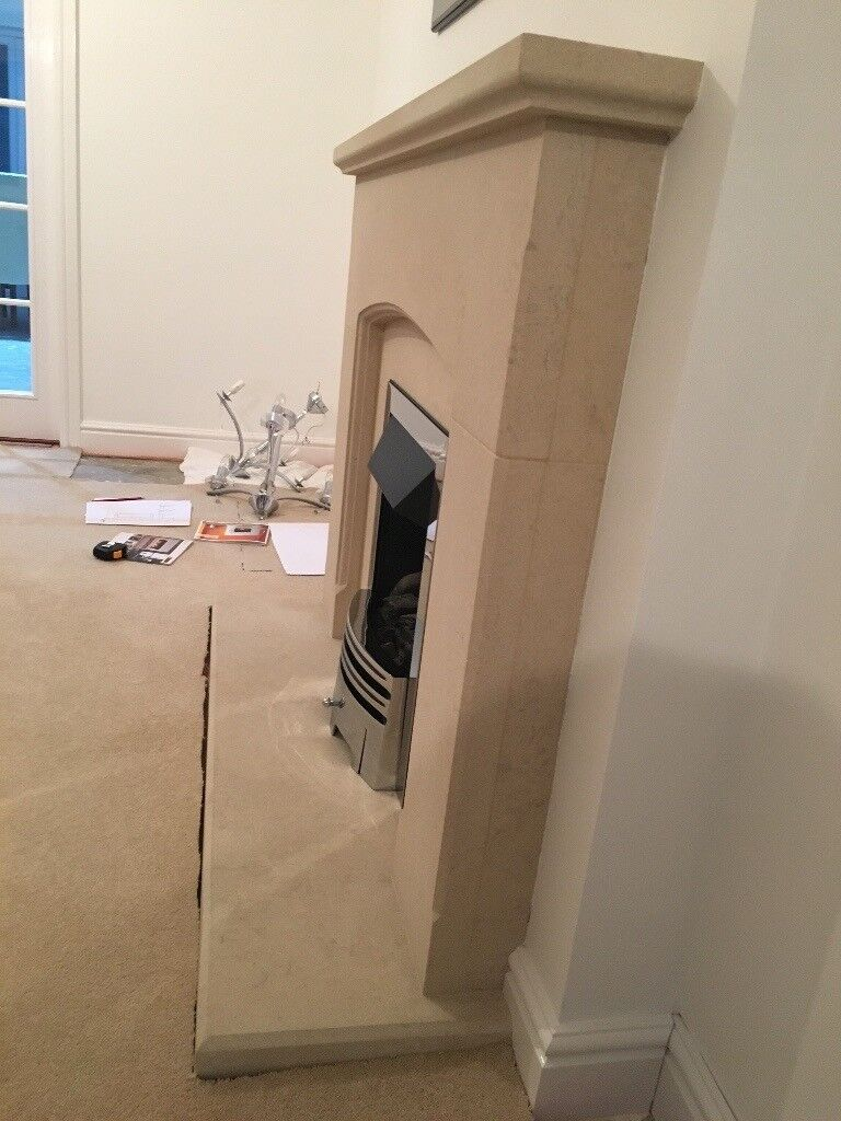 sandstone fireplace with gas fire in coalville leicestershire