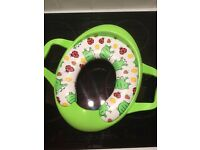 Toddler toilet trainer seat with frog design