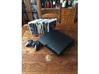 PlayStation 3 with controller and 9 games