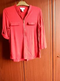 Lady's red top roll up sleeves. Size medium. Never worn.