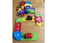 V-Tech 33 piece track and 2 sounds vehicles