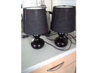2 small black bedside lamps