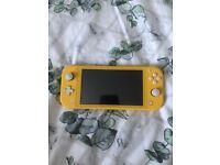 Nintendo Switch Lite yellow + Animal crossing