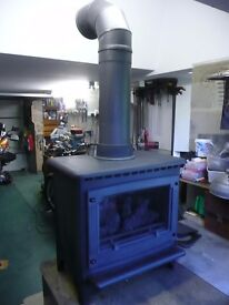 Gazco log effect stove, medium size. Top or rear vented balanced flu. Can deliver locally.