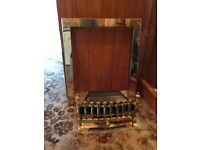 Living flame gas fire with Blenheim brass front and brass surround. Used I. Excellent condition.