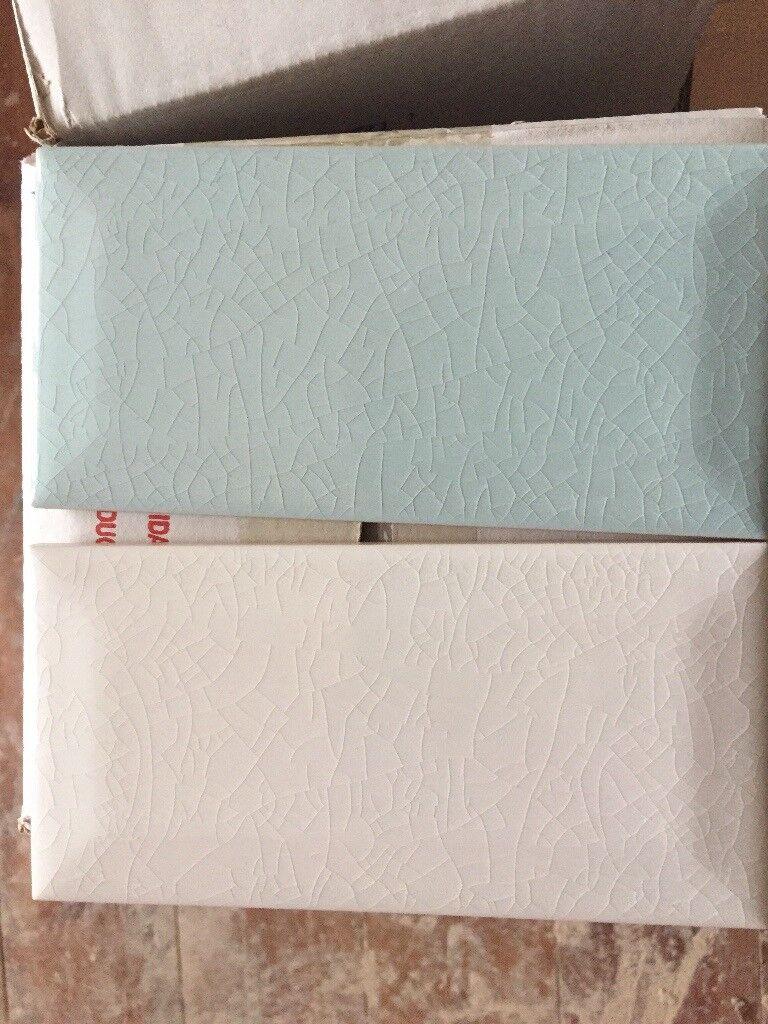 Blue and white ceramic crackle glaze tiles. 150mmx75mm.