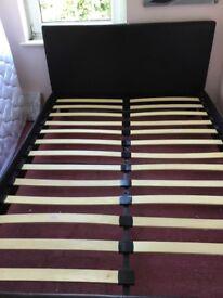 Black faux leather upholstered bed frame.