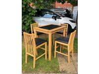 Dining table and 4 chairs (higher than usual)