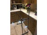 Adjustable height 2 tier clothes rail