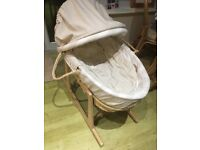 Mamas & Papas Moses basket with rocking stand.