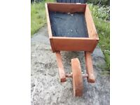 Hand made wheelbarrow planter, new, lined, large