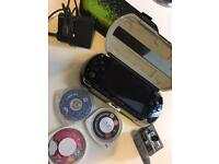 PSP 1003 (£40) With 3 games,Camera and 2 Cases. BARGAIN!!
