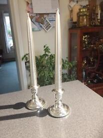 Pair of Silver plate candlesticks with candles