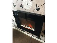 Remote control wall mounting electric fire comes complete with a remote control