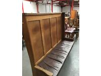oak antique settle with leather padded seating