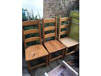 4 solid wood (oak?) dining room chairs