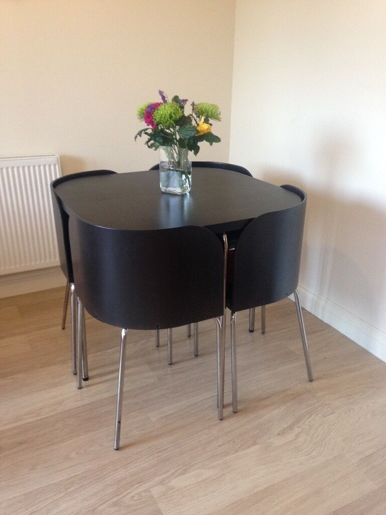 Ikea dining table and four chairs neat space saving for Space saving dining table