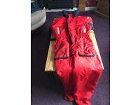 One piece flotation suit