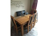 Solid Oak extendable dining table and matching chairs