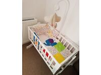 New swinging crib with new mattress and obaby bed cover set also with musical cot toy