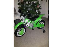 Kids green electric motor bike