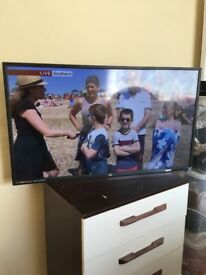"""TV 40"""" not a year old with remote reasons for sale got a bigger TV in bedroom selling for £120"""