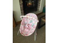 Pink 'bright star' baby bouncer. Excellent condition- hardly used.