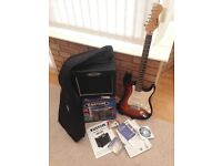 Encore black and brown/orange electric guitar and amp with accessories like new barely used