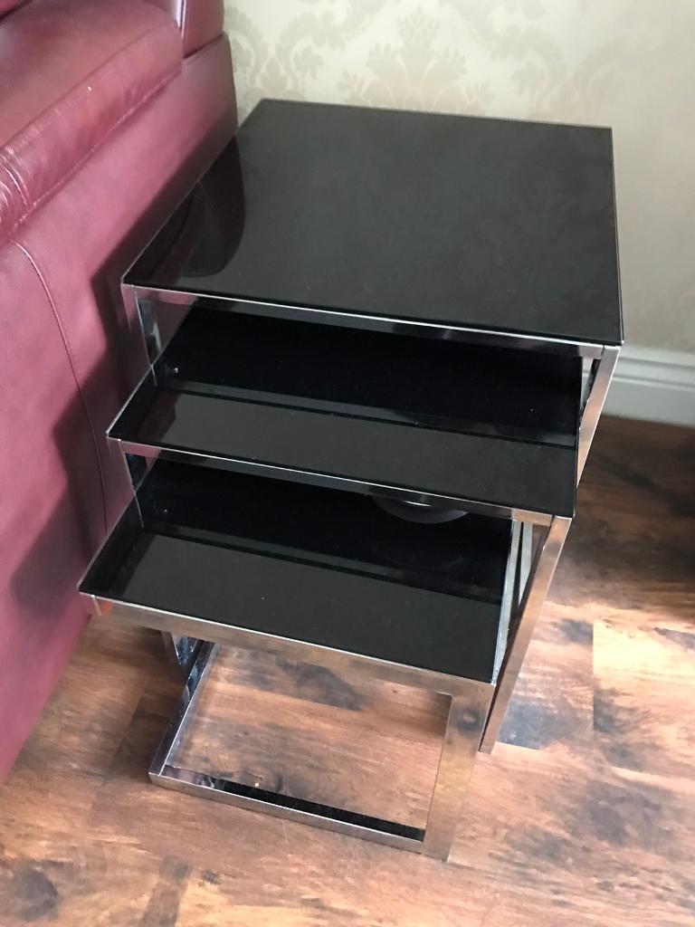 Nest of three glass black tables