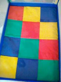 Colourful travel cot