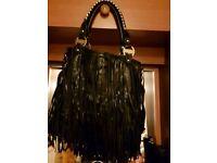 Black leather tassel handbag