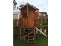 Wooden custom built raised playhouse