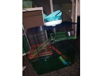 Gerbil/hamster cage for sale £20. Barely used , comes with wheel , water bottle and feeding bowl .