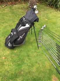 Full set of Wilson Augusta golf clubs, carry bag, putter and umbrella.
