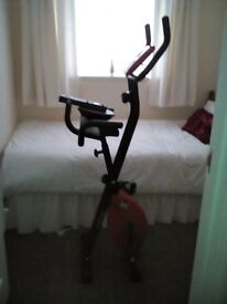 Comfort plus folding exercise bike with back rest and digital display as new.