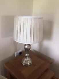 Beautiful new lamp in neutral colour with silver base.