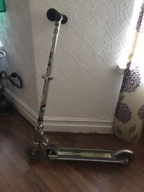 Silver push scooter